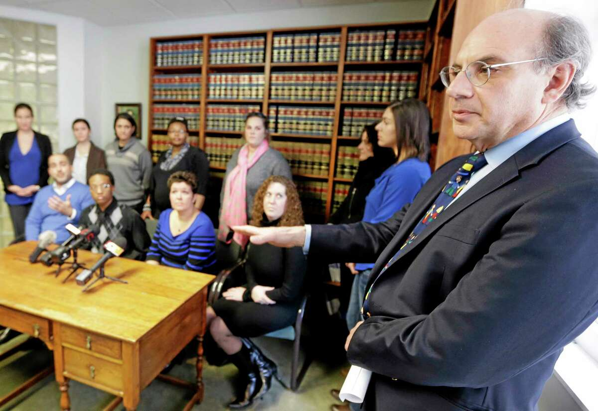 Attorney Alphonse Gerhardstein, right, during a news conference in Cincinnati with several gay couples he is representing in a federal civil rights lawsuit over gay marriage rights in this 2014 archive photograph.