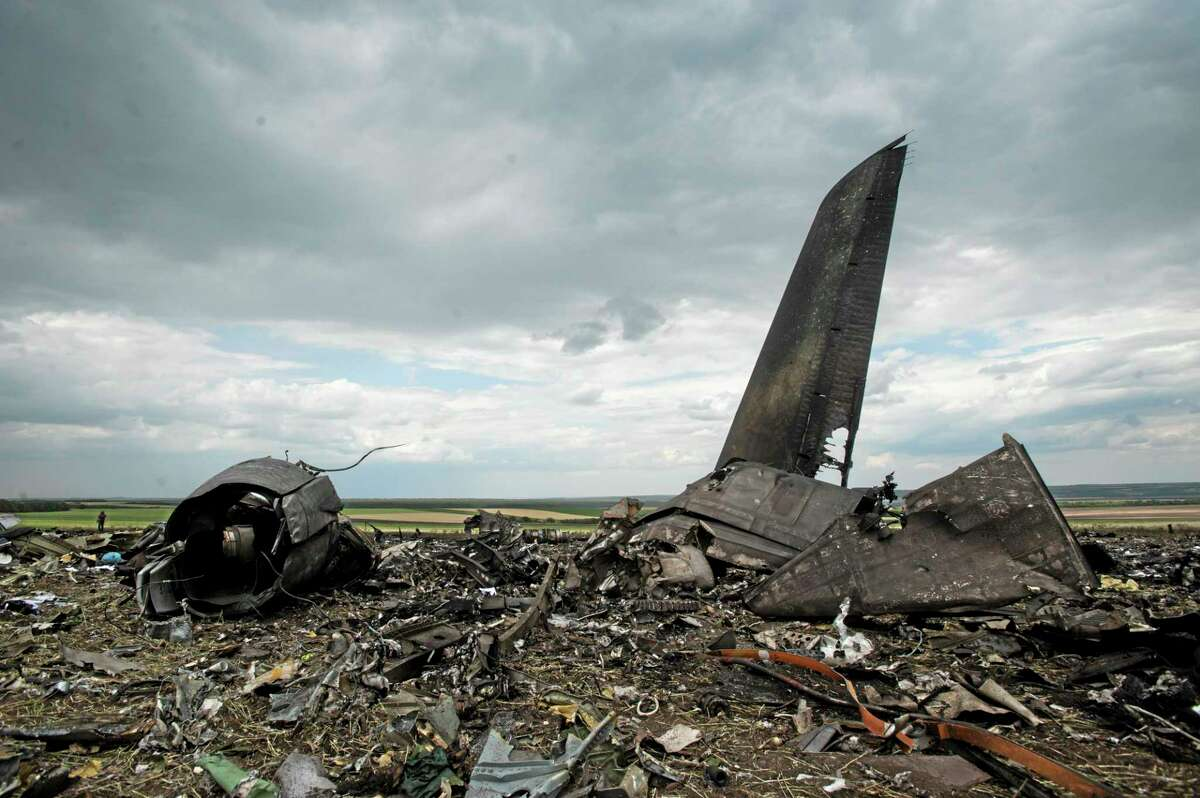 Remnants of a downed Ukrainian army aircraft Il-76 at the airport near Luhansk, Ukraine, Saturday, June 14, 2014. Pro-Russian separatists shot down the military transport plane Saturday in the countryís restive east, killing all 49 service personnel on board, Ukrainian officials said. (AP Photo/Evgeniy Maloletka)