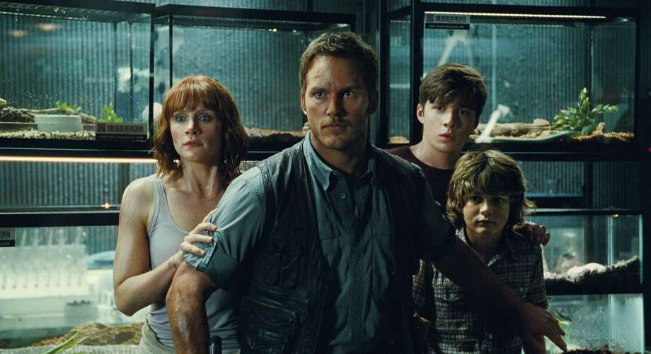 "This photo provided by Universal Pictures shows, Bryce Dallas Howard, from left, as Claire, Chris Pratt as Owen, Nick Robinson as Zach, and Ty Simpkins as Gray, in a scene from the film, ""Jurassic World,"" directed by Colin Trevorrow. Photo: Universal Pictures/Amblin Entertainment Via AP  / Universal Pictures"