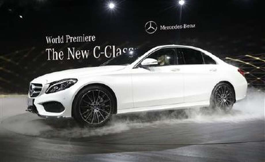 Mercedes Benz unveils the new C-Class car during a preview night for the North American International Auto Show in Detroit, Sunday, Jan. 12, 2014. (AP Photo/Carlos Osorio) Photo: AP / AP