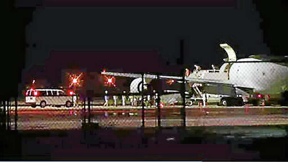 CORRECTS BYLINE - In this image from video people are greeted on arrival at Lackland Air Force Base in San Antonio Texas early Friday morning June 13, 2014. Bowe Bergdahl, the Army sergeant who has been recovering in Germany after five years as a Taliban captive, returned to the United States on this plane early Friday to continue his medical treatment. (AP Photo/AP Video, Manis Calco) Photo: AP / ap