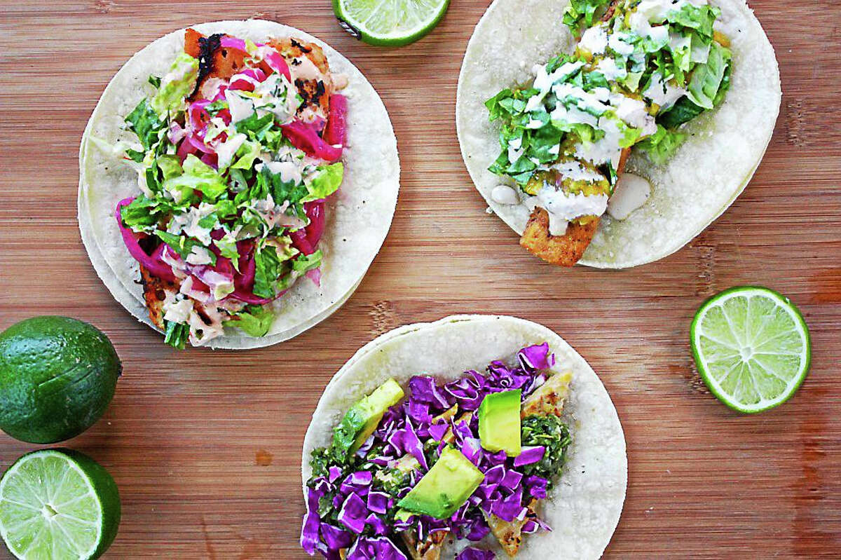 Lime's tang balances the creamy avocado dip that's drizzled on these colorful tacos created by the I.O.N. Restaurant kitchen.