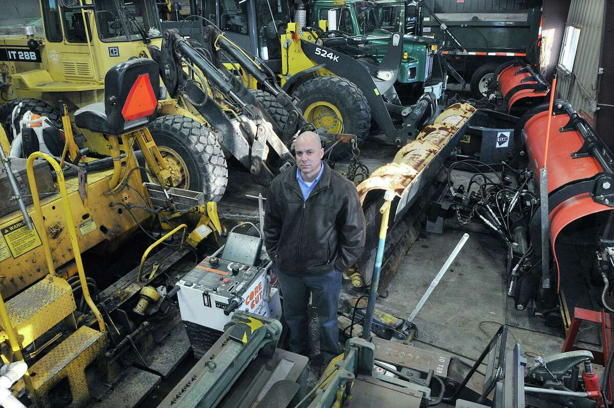 Jon Harriman, Cromwell's town engineer and acting public works director, stands in the cramped town garage in this file photo.