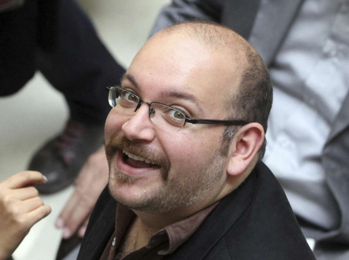 FILE - In this photo April 11, 2013 file photo, Jason Rezaian, an Iranian-American correspondent for The Washington Post, smiles as he attends a presidential campaign of President Hassan Rouhani in Tehran, Iran. Iran's official IRNA news agency says the detained Washington Post correspondent is back in court on Monday, June 8, 2015 for the second closed-door hearing in his espionage trial.(AP Photo/Vahid Salemi, File)