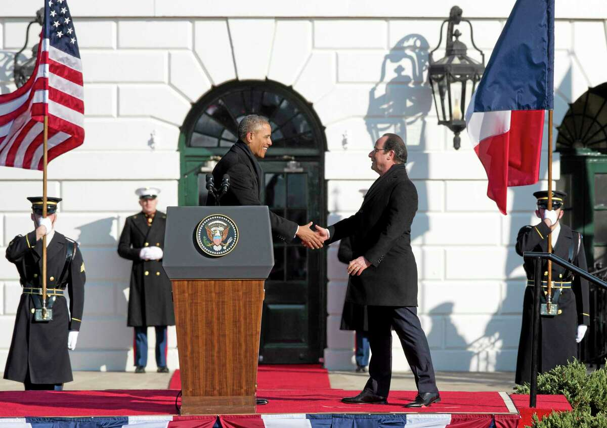 President Barack Obama and French President FranÁois Hollande shake hands during a state arrival ceremony on the South Lawn of the White House in Washington, Tuesday, Feb. 11, 2014. Overshadowed by the intrigue of a European love triangle and a glamorous White House gala, Tuesday's policy talks between President Barack Obama and French President Francois Hollande will showcase a revamped relationship that is now a cornerstone of diplomatic efforts in Iran and Syria, as well as the fight against extremism in northern Africa. (AP Photo/ J. Scott Applewhite)