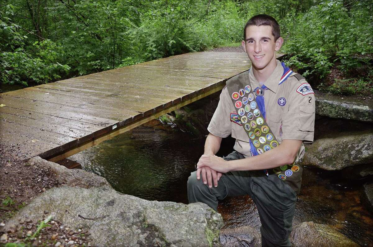 Catherine Avalone - The Middletown Press Eagle Scout Andrew Donahue, stands at one of two foot bridges he built at the Portland Reservoir for his Eagle Scout Service Project. Donahue is a member of Troop 2 chartered by the Portland Volunteer Fire Department Company 2 and a senior at Portland High School.