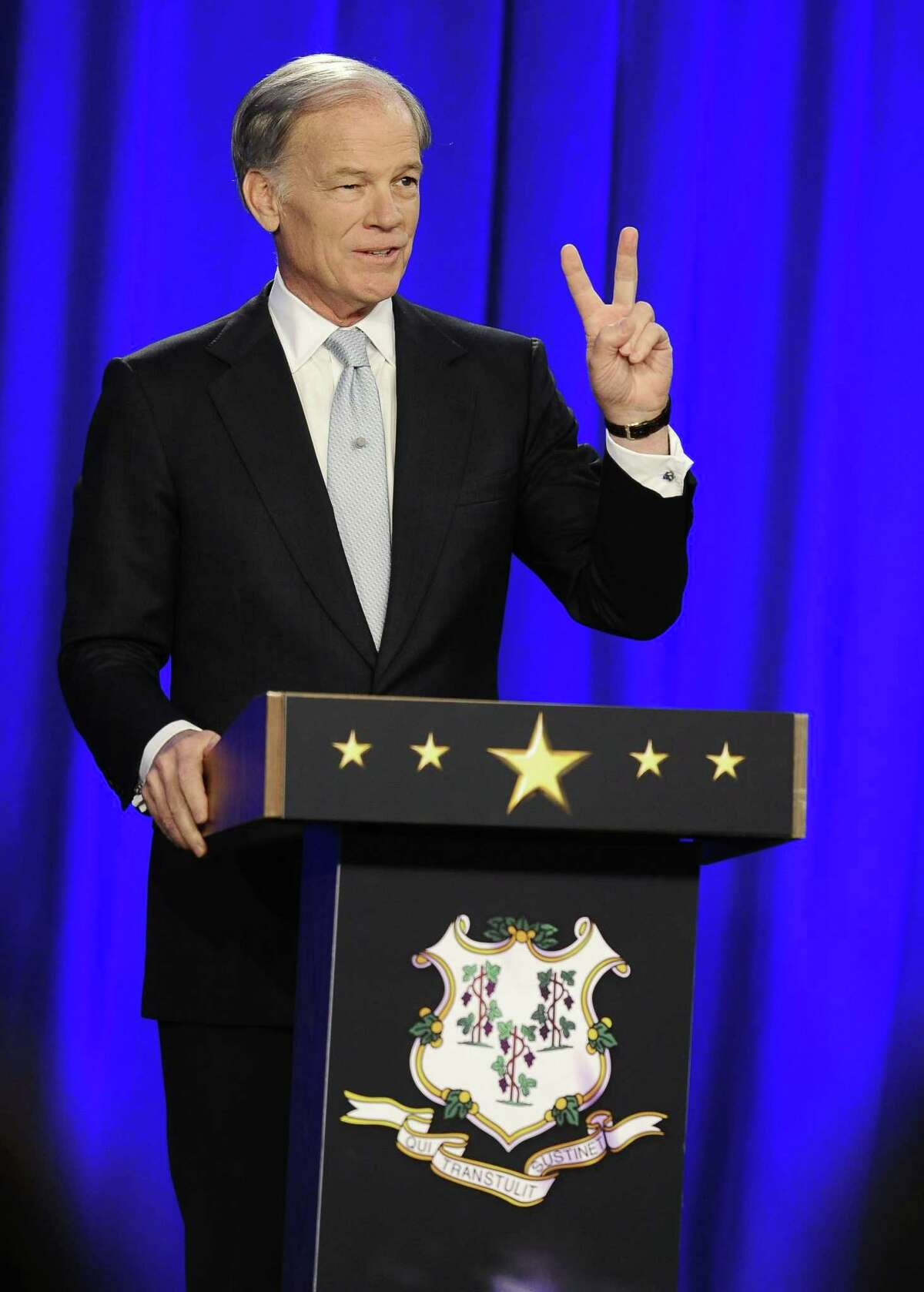 Republican candidate for governor Tom Foley gestures as he speaks during a debate with Gov. Dannel P. Malloy Thursday in Hartford.