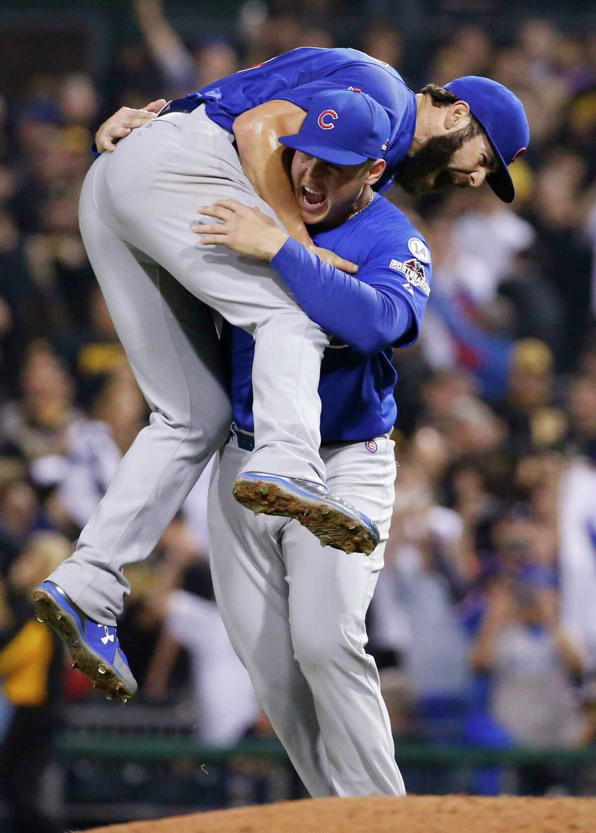 Chicago Cubs first baseman Anthony Rizzo holds starter Jake Arrieta after they defeated the Pirates in the National League wild-card game 4-0 Wednesday in Pittsburgh. The Cubs advance to play the St. Louis Cardinals in the NLDS.