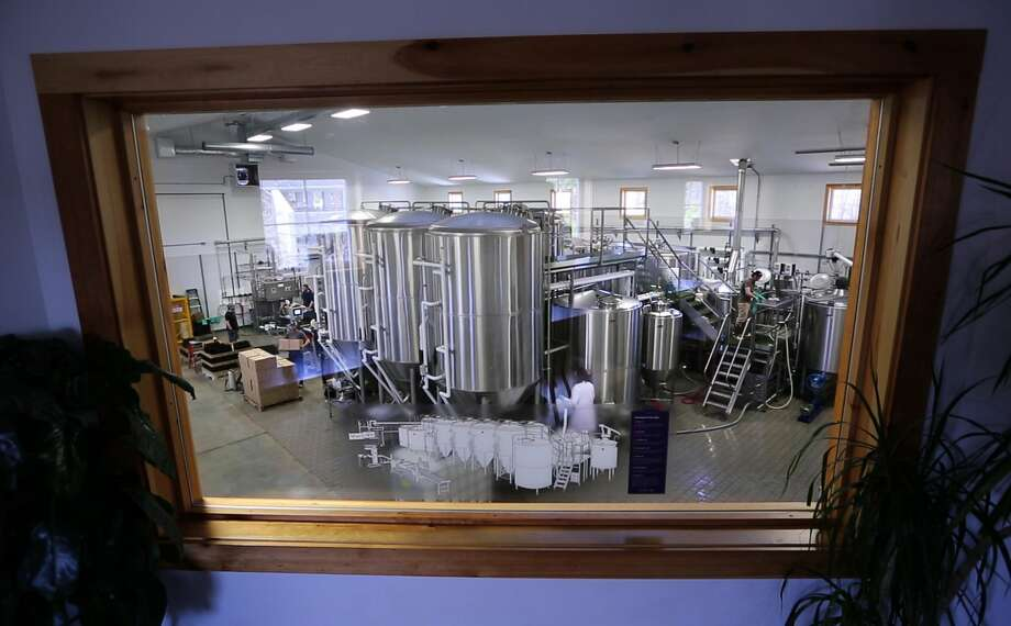 Dan Kleban, a co-owner of the Maine Beer Company, poses in the company's tasting room in Freeport, Maine. Photo: Robert F. Bukaty — The Associated Press  / AP