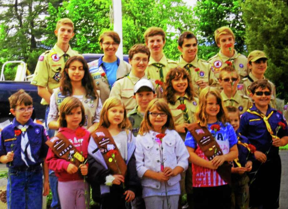 Submitted photo Cromwell Boy Scouts were front and center in helping the local American Legion Post No. 105 pay tribute to the veterans buried in four Cromwell cemeteries in advance of Memorial Day. Photo: Journal Register Co.