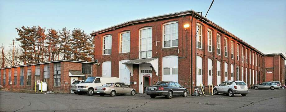 The Remington Rand former factory building on Johnson Street in Middletown's North End is classified as brownfields. Photo: File Photo  / TheMiddletownPress