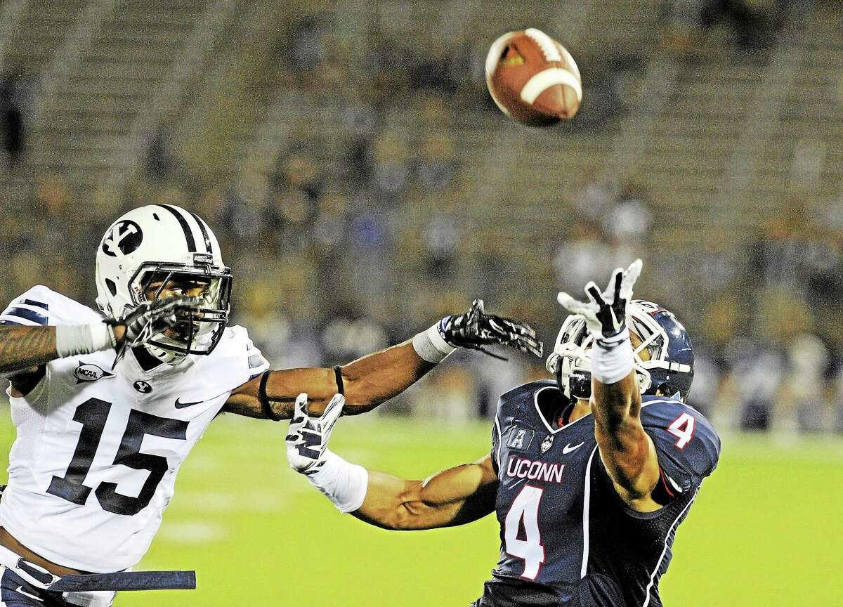Cornerback Michael Davis (15) covers UConn wide receiver Deshon Foxx during the second half of the Huskies' Aug. 29 game against BYU at Rentschler Field in East Hartford.