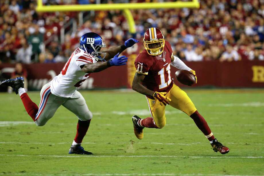 New York Giants cornerback Prince Amukamara (20) closes in on Washington Redskins receiver DeSean Jackson (11) during a Sept. 25 game in Landover, Md. Photo: Alex Brandon — The Associated Press  / AP