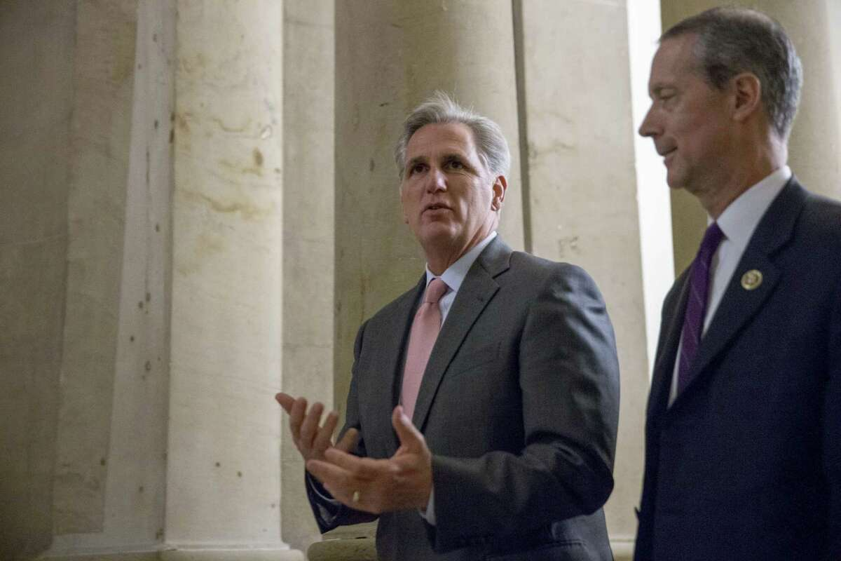 AP Photo/Andrew Harnik, File In this Sept. 30, 2015, file photo, House Majority Leader Kevin McCarthy of Calif., left, walks on Capitol Hill in Washington. McCarthy says he regrets comments suggesting the House special committee on Benghazi has political goals. McCarthy says he never intended to make that suggestion. He says the purpose of the committee is to find out the truth and it has nothing to do with politics.