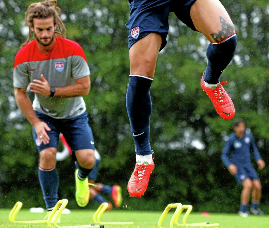 United States' Jermaine Jones, front, and Kyle Beckerman work out during a training session earlier this week. Photo: Julio Cortez — The Associated Press  / AP