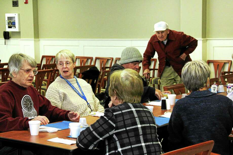 Middletown seniors gather for a midday meal recently at the city's senior center located on Durant Terrace. Programs like Gatekeeper help provide a low-cost safety net to ensure that our seniors can age safely at home, in dignity and with self-determination. Photo: Kathleen Schassler —Middletown Press  / Kathleen Schassler All Rights