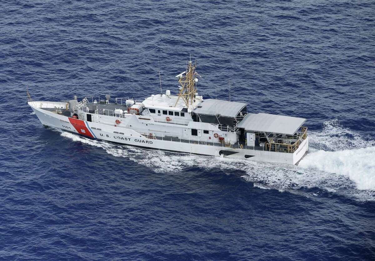 In this, Tuesday, May 19, 2015, photo, U.S. Coast Guard cutter Bernard C. Webber is shown off the coast of Fort Lauderdale, Fla. Despite a historic shift in the relationship between the governments on either side of the Florida Straits, the U.S. Coast Guard still plays a deadly hide-and-seek with Cuban migrants on the high seas, returning to the communist island anyone they catch. (AP Photo/Wilfredo Lee)