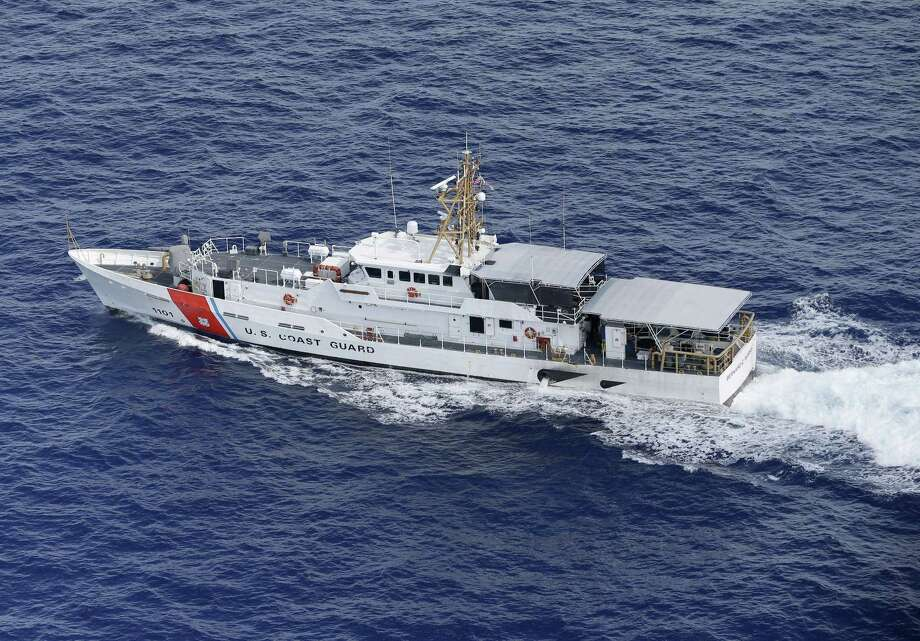 In this, Tuesday, May 19, 2015,  photo, U.S. Coast Guard cutter Bernard C. Webber is shown off the coast of Fort Lauderdale, Fla. Despite a historic shift in the relationship between the governments on either side of the Florida Straits, the U.S. Coast Guard still plays a deadly hide-and-seek with Cuban migrants on the high seas, returning to the communist island anyone they catch.  (AP Photo/Wilfredo Lee) Photo: AP / AP