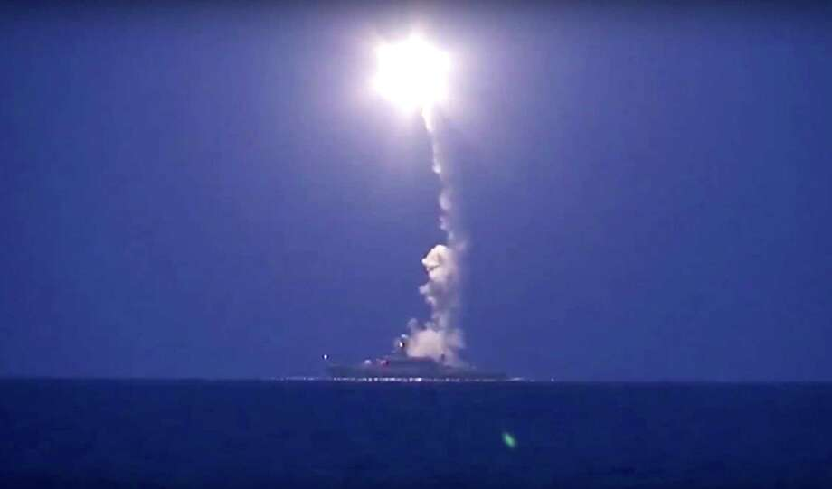 In this photo made from the footage taken from Russian Defense Ministry official web site, Wednesday, Oct. 7, 2015, a Russian navy ship launches a cruise missile in the Caspian Sea. Russia's Defense Minister Sergei Shoigu said fourRussian navy ships in the Caspian launched 26 cruise missiles at Islamic State targets in Syria. Photo: Russian Defense Ministry Press Service Via AP   / Russian Defense Ministry Press Service