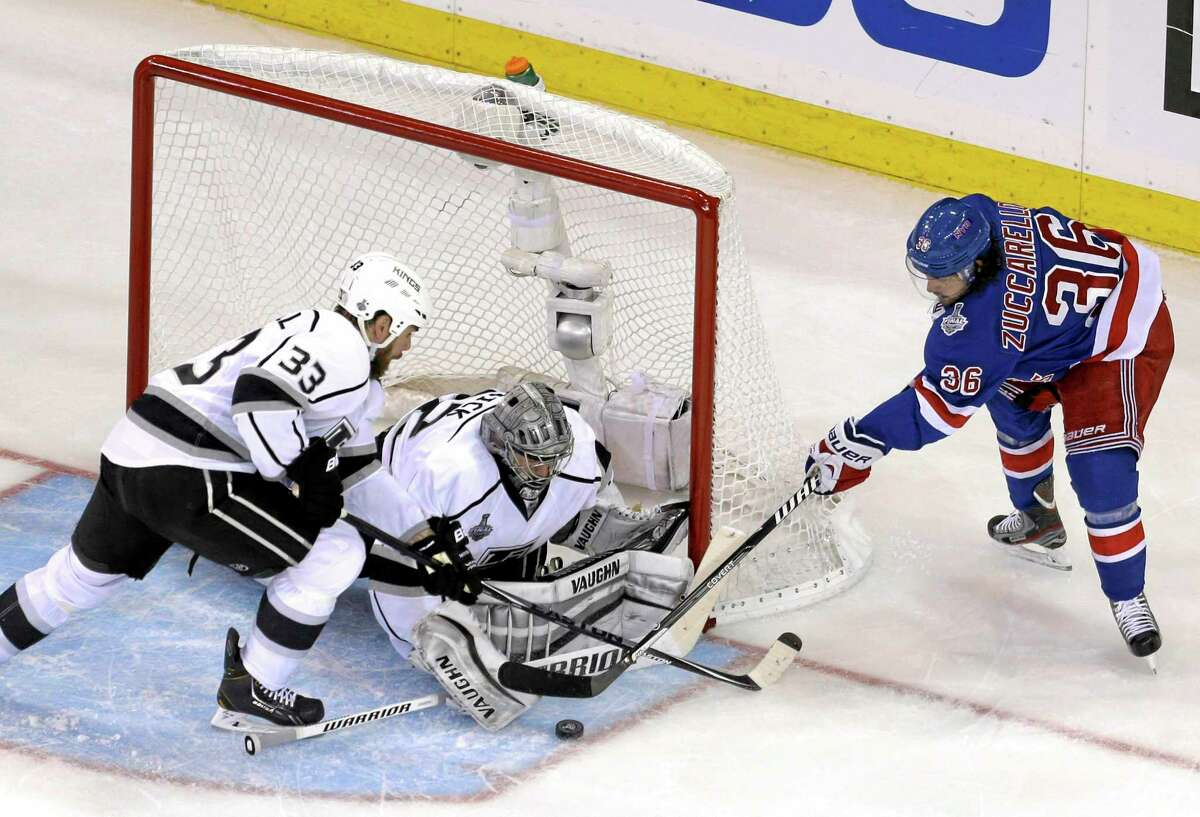 Rangers right wing Mats Zuccarello (36), right, tries to score past Los Angeles Kings goalie Jonathan Quick during Game 4 on Wednesday.