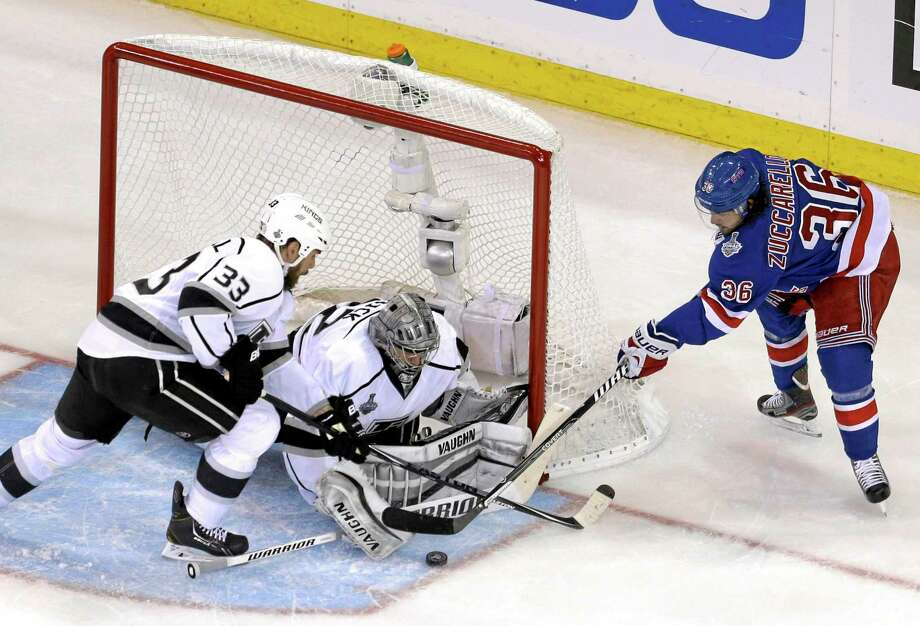 Rangers right wing Mats Zuccarello (36), right, tries to score past Los Angeles Kings goalie Jonathan Quick during Game 4 on Wednesday. Photo: Seth Wenig — The Associated Press  / AP