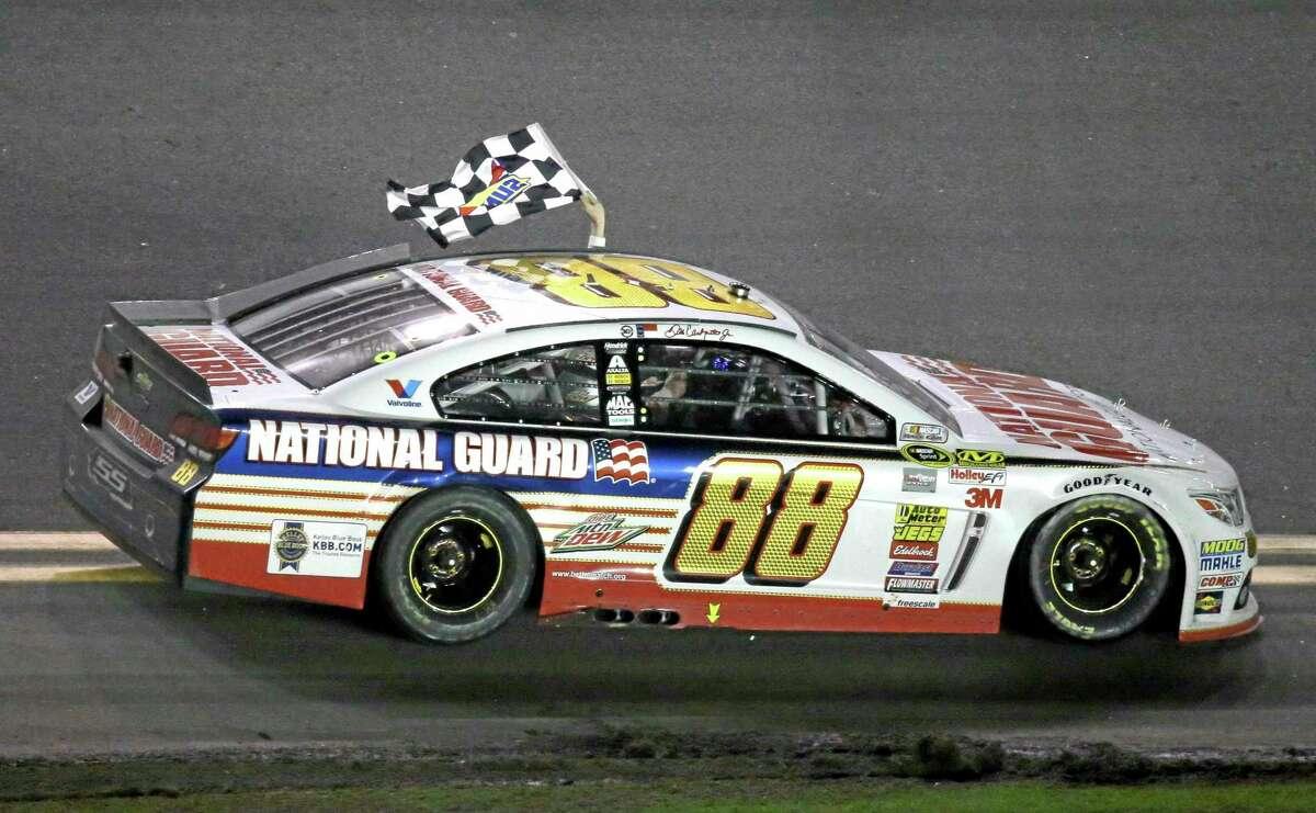 Dale Earnhardt Jr. takes a victory lap after winning the Daytona 500 Sunday.
