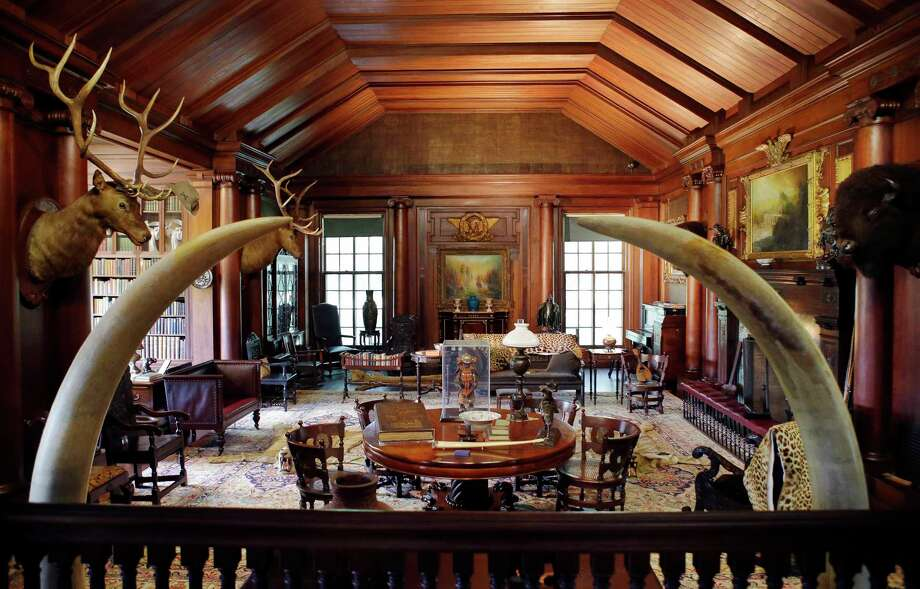 "In this June 9, 2015, photo, elk and bison heads along with mementos President Theodore Roosevelt received adorn the North Room, the 26th president's ""trophy room,"" at Sagamore Hill, his summer White House in Oyster Bay, N.Y.  Sagamore Hill reopens July 12 after a $10 million, four-year renovation by the National Park Service. (AP Photo/Kathy Willens) Photo: AP / AP"
