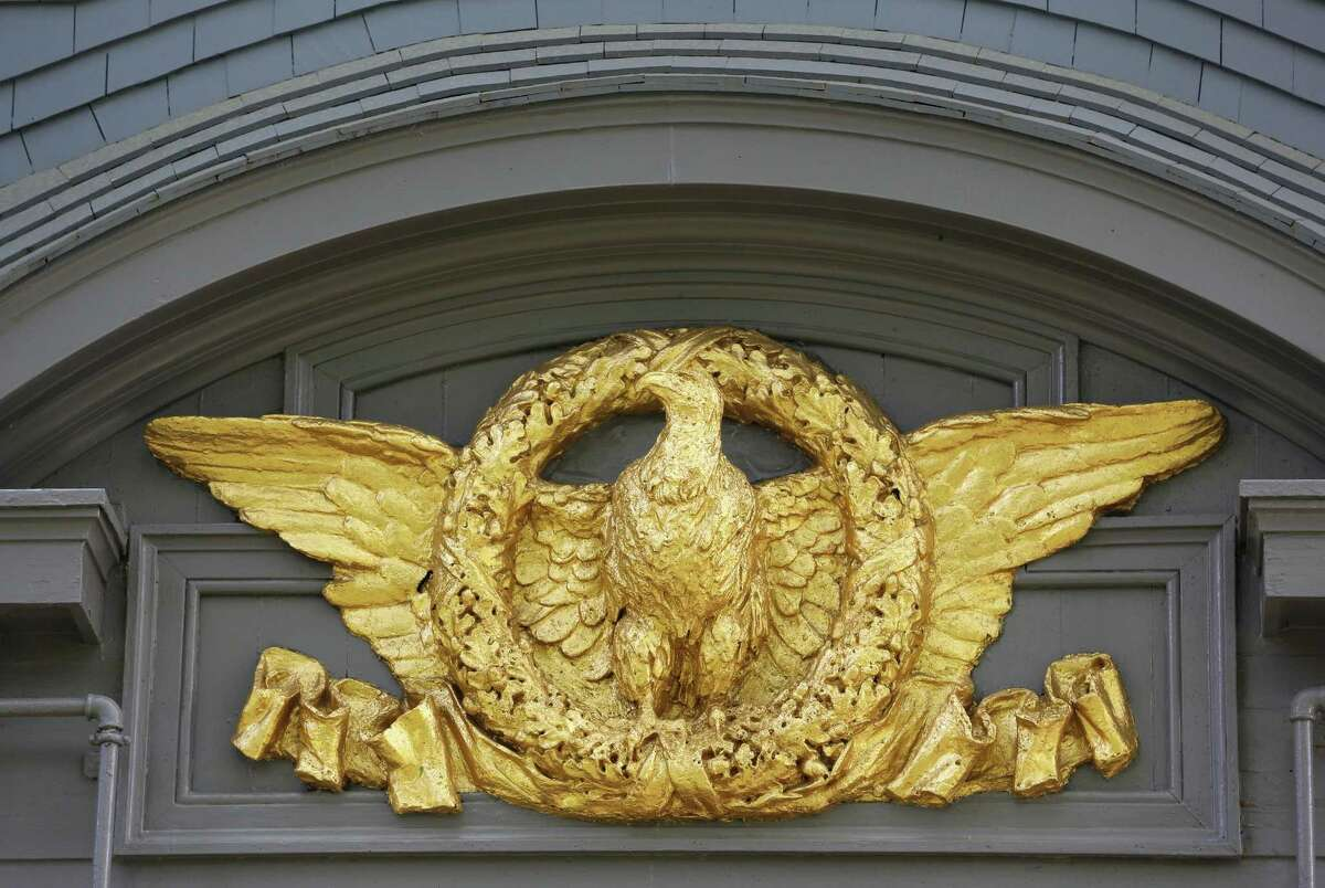 This June 9, 2015, photo, shows a gold-leaf covered eagle on the exterior of President Theodore Roosevelt's 28-room Sagamore Hill mansion that served as his summer White House in Oyster Bay, N.Y., (AP Photo/Kathy Willens)