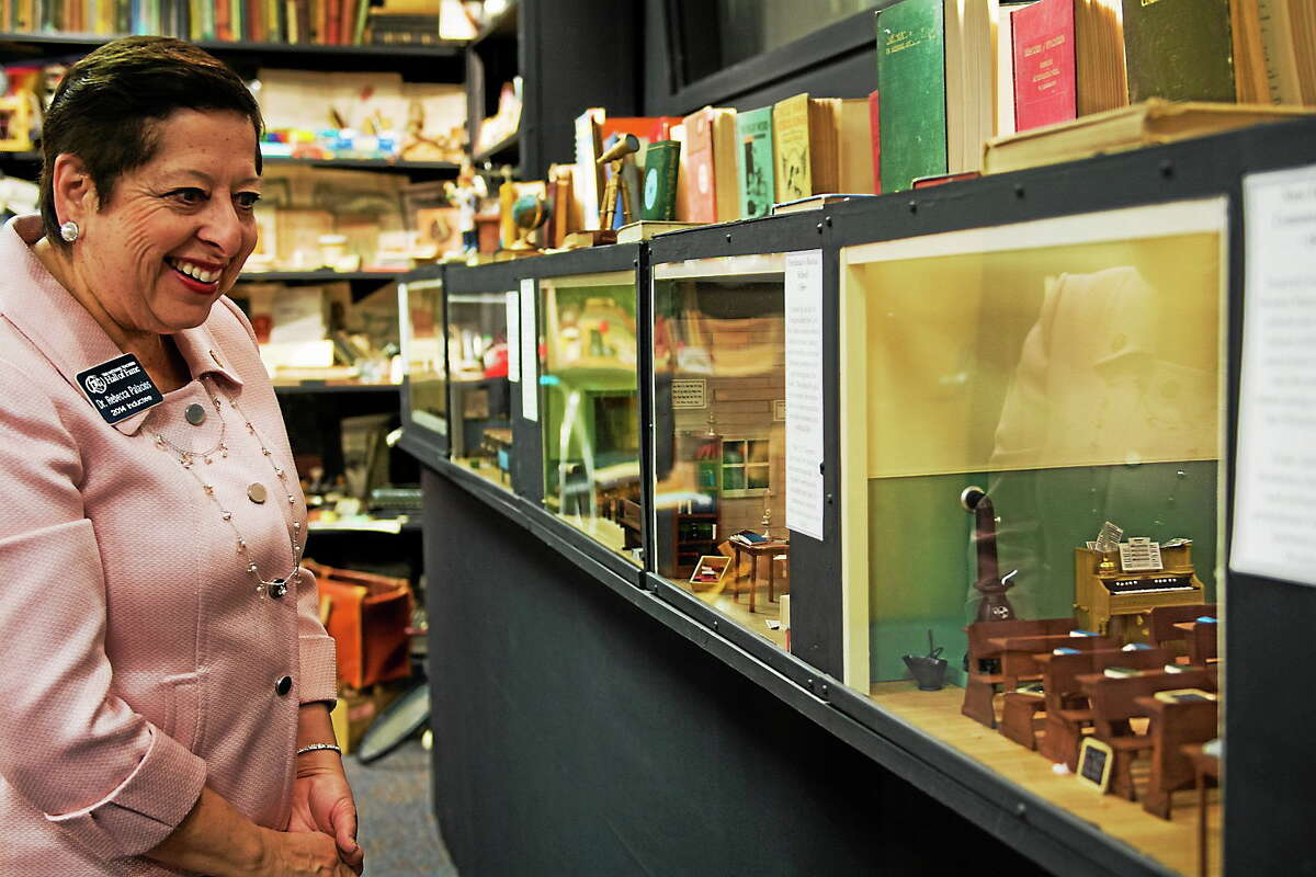 Rebecca Palacios, an early childhood educator from Corpus Christi, Texas, and 2014 inductee into the National Teachers Hall of Fame, walks along a display case of classroom dioramas at the hall in Emporia, Kan. The hall will dedicate a memorial to educators who have been killed on the job.