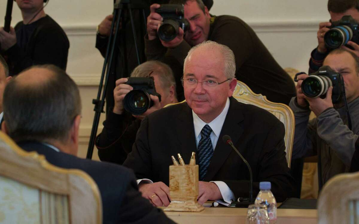 Venezuelan Foreign Minister Rafael Ramirez listens to Russian Foreign Minister Sergey Lavrov, left, during talks in Moscow, Russia, Wednesday, Oct. 8, 2014. (AP Photo/Ivan Sekretarev)