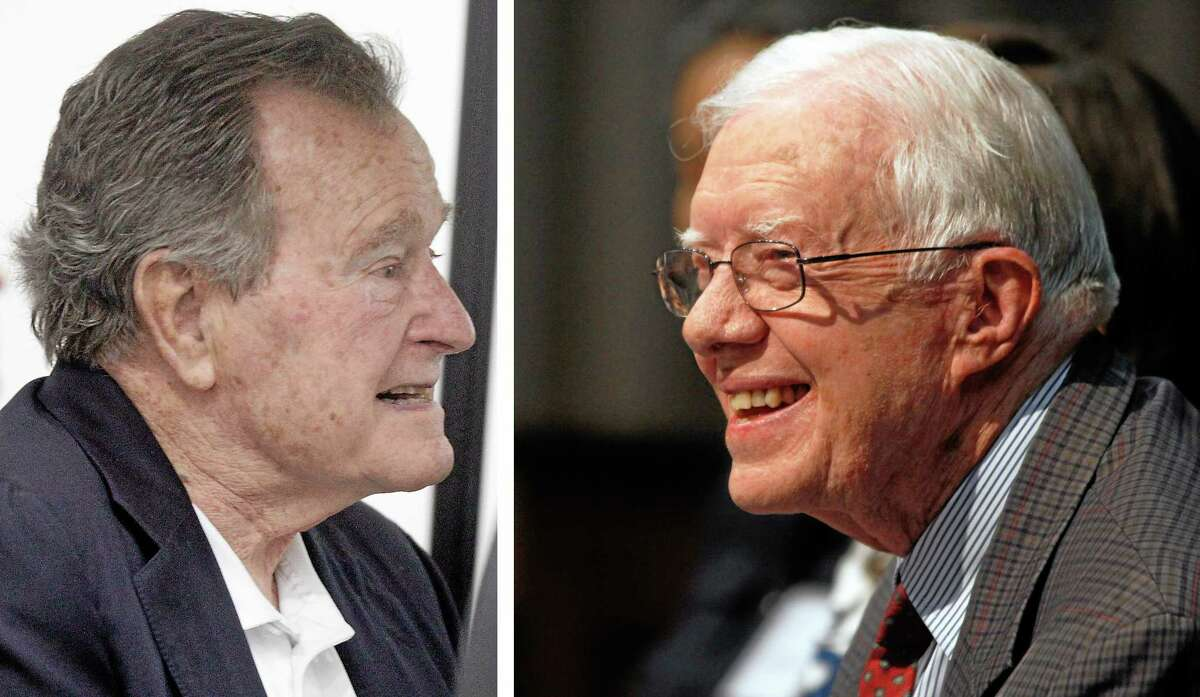 Former President George H.W. Bush, left, is seen in this March 27, 2014, file photo taken in College Station, Texas, and former President Jimmy Carter is seen in a June 28, 2013, file photo taken in Atlanta, Georgia. Bush celebrates his 90th birthday Thursday June 12, 2014. Carter is 89.
