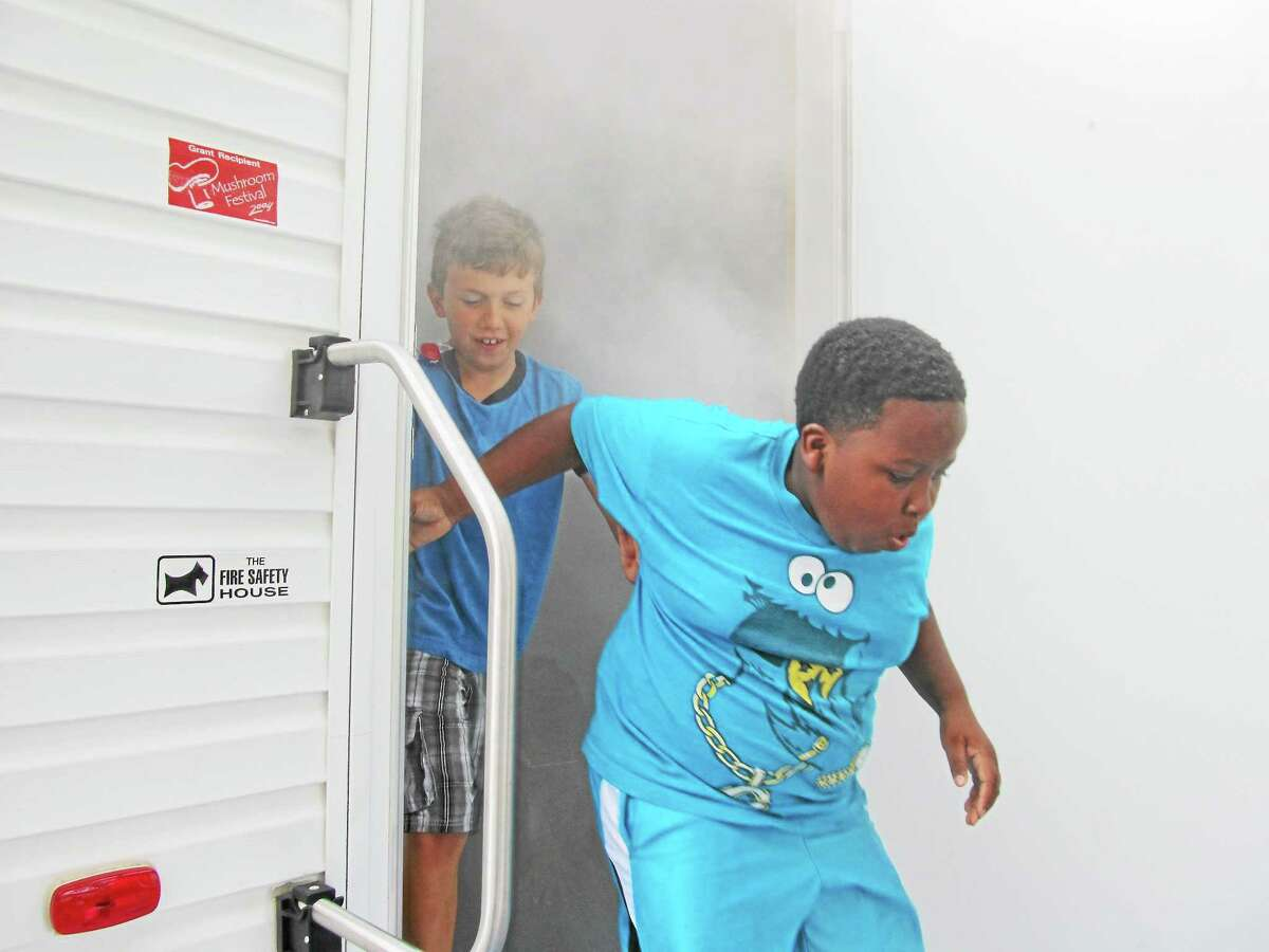 Left, children exit a fire station smoke house trailer, which Middletown firefighters will have on hand to teach safety in an emergency this weekend. Middletown's Health & Safety Day Saturday will include face painting for children.