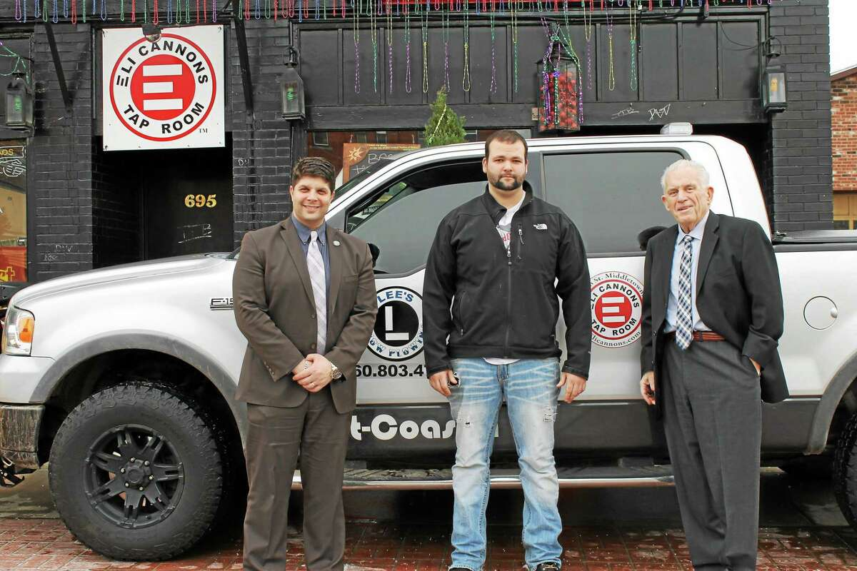 Mayor Dan Drew, Lee Rapp of Lee's Snow Plowing and Chamber President Larry McHugh are seen outside Eli Cannon's in Middletown. Lee's Snow Plowing was welcomed as a new chamber member.