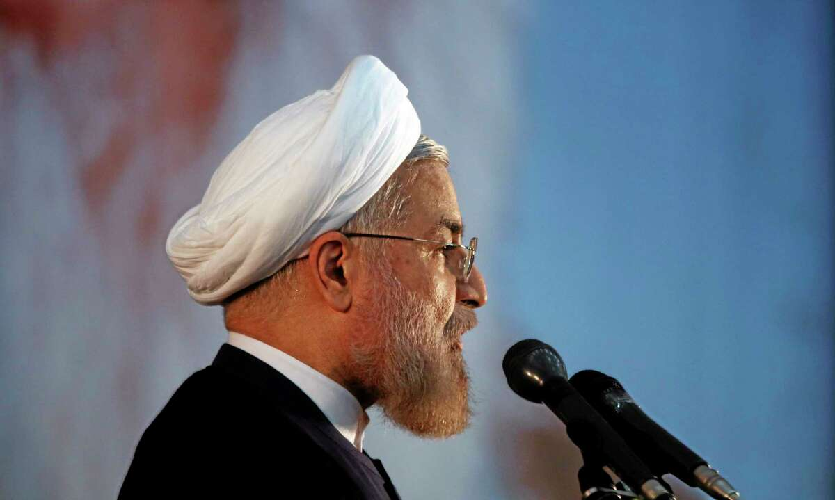 In this recent photo, Iranian President Hassan Rouhani makes an address during a ceremony marking the 25th death anniversary of Ayatollah Khomeini, the founder of the Islamic Republic, at his shrine just outside Tehran, Iran, in early June. Iran's moderate president said Tuesday that his administration will defend the Islamic Republic's nuclear rights and work to end international sanctions that have devastated its economy.