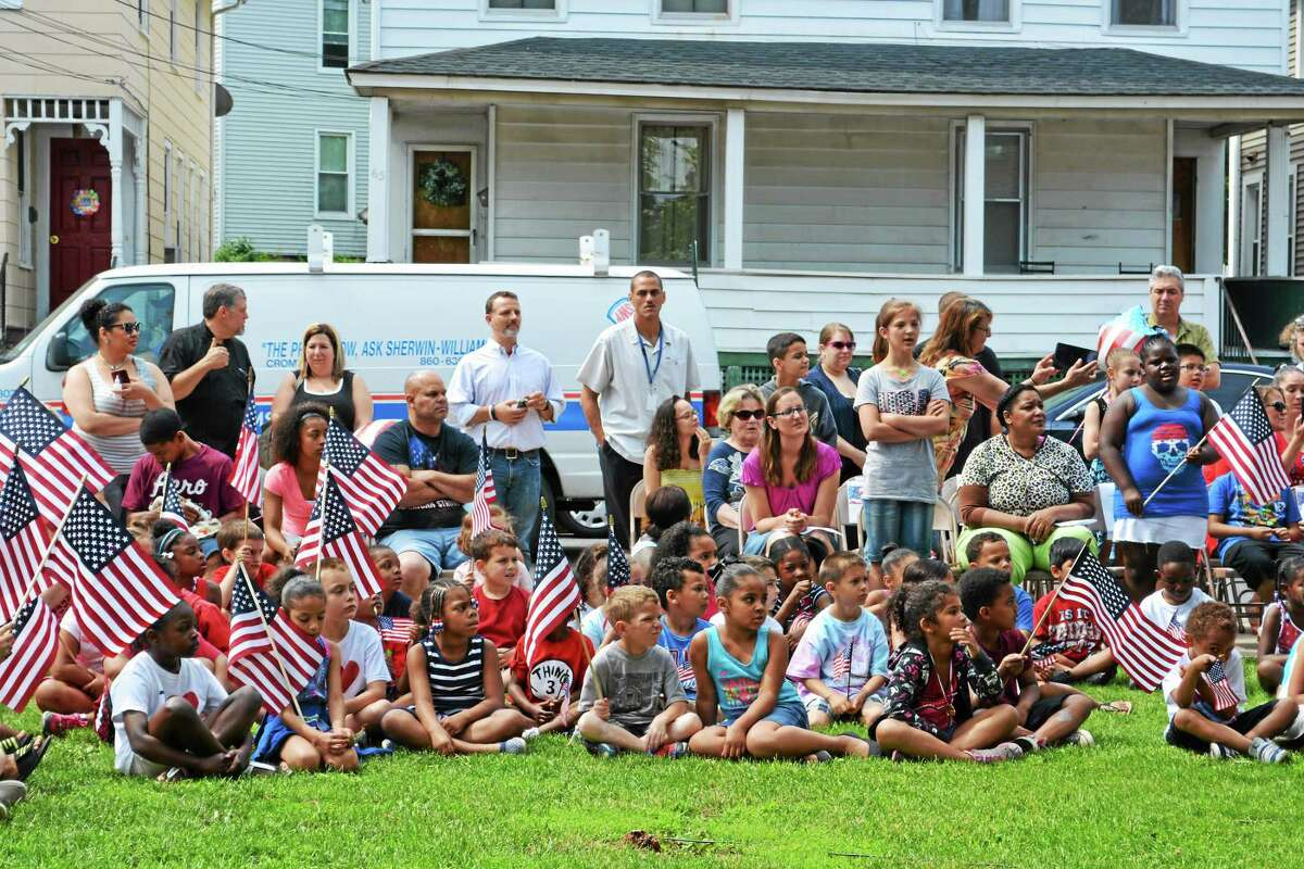 Macdonough school staff, parents, teachers and community members pay tribute to the American Flag on Friday. It's a colorful and musical tradition at Middletown's North End elementary.