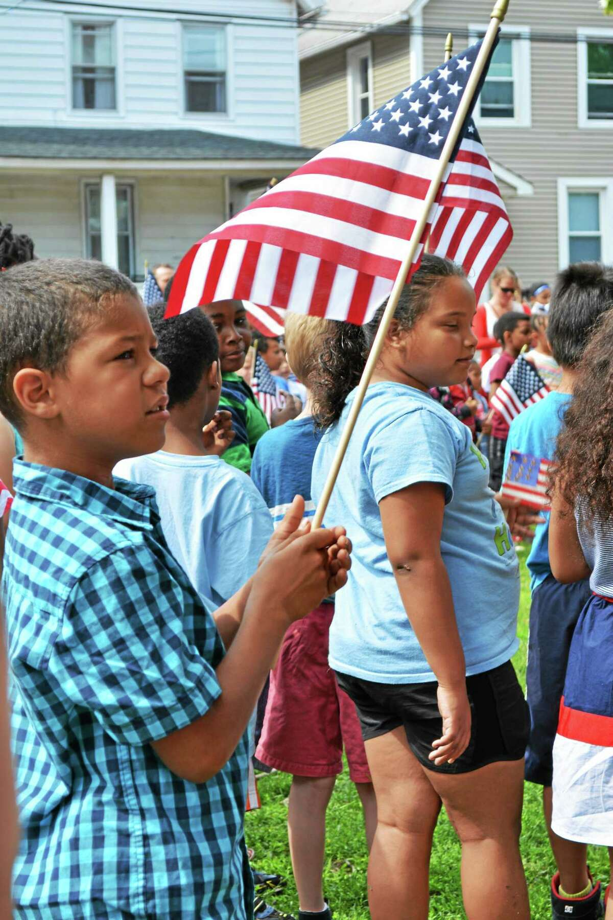 Brian Zahn - The Middletown Press Macdonough school staff, parents, teachers and community members pay tribute to the American Flag on June 12. It's a colorful and musical tradition at Middletown's North End elementary.