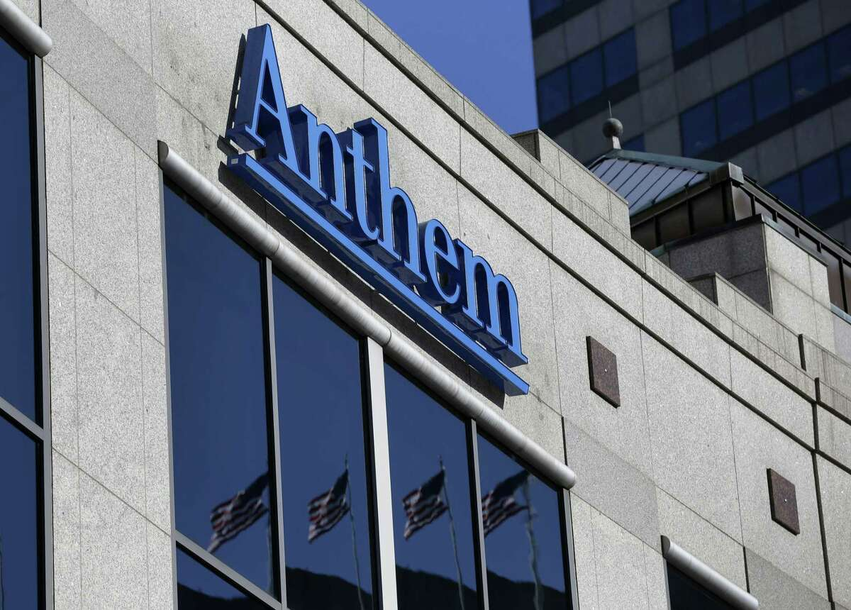 In this Feb. 5, 2015 photo, the Anthem logo hangs at the health insurer's corporate headquarters in Indianapolis.