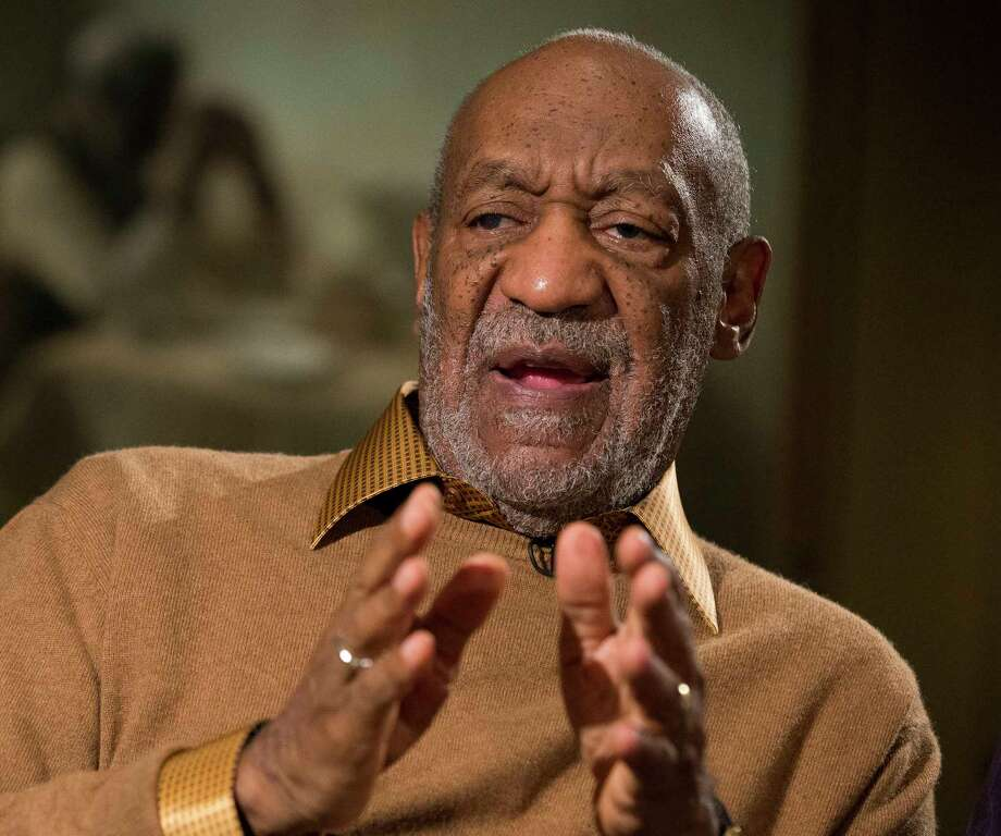 "In this Nov. 6, 2014 photo, entertainer Bill Cosby gestures during an interview about the upcoming exhibit, ""Conversations: African and African-American Artworks in Dialogue,"" at the Smithsonian's National Museum of African Art, in Washington. Photo: AP Photo/Evan Vucci, File  / AP"