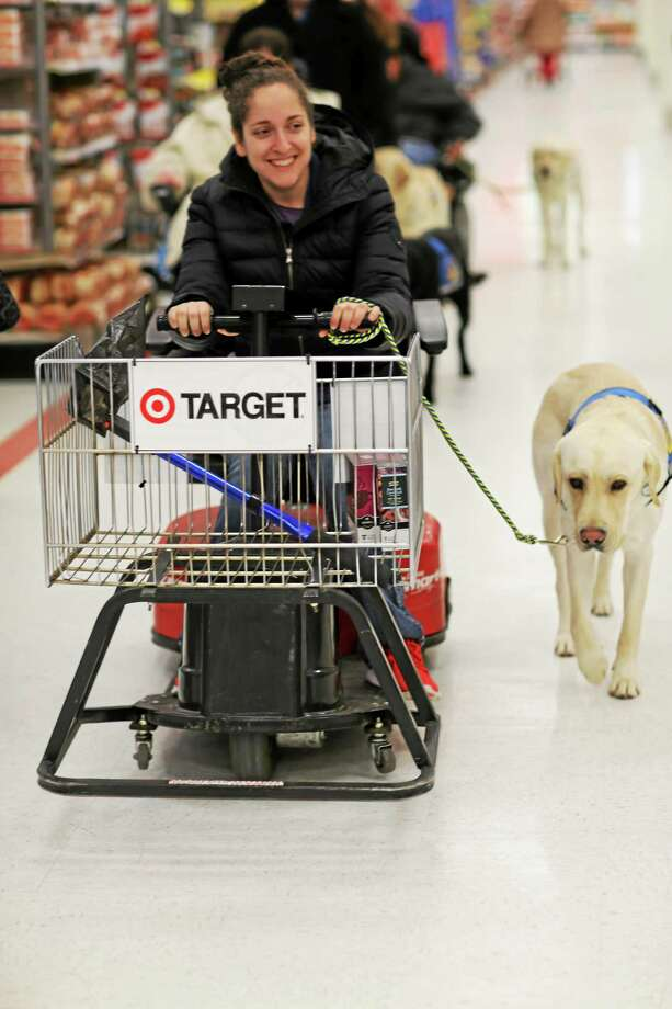 Middletown resident Molly Carta was born with cerebral palsy. Her service dog allows her to manage her own errands, like shopping. Photo: Courtesy Photo