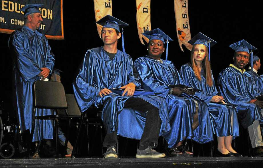 Viktoria Sundqvist - The Middletown Press Class speaker Reynaldo Rodriguez and scholarship winners Josette A. Hill-White and Tessa Warzecha listen to Middletown Adult Education Director James Misenti during Wednesday's graduation ceremony at Middletown High School. Photo: Journal Register Co.
