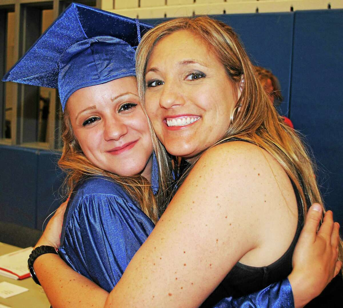 Viktoria Sundqvist - The Middletown Press English teacher Cathleen Cody, left, hugs student Chelsea A. Gauthier before heading into Middletown Adult Education's graduation ceremony Wednesday at Middletown High School.