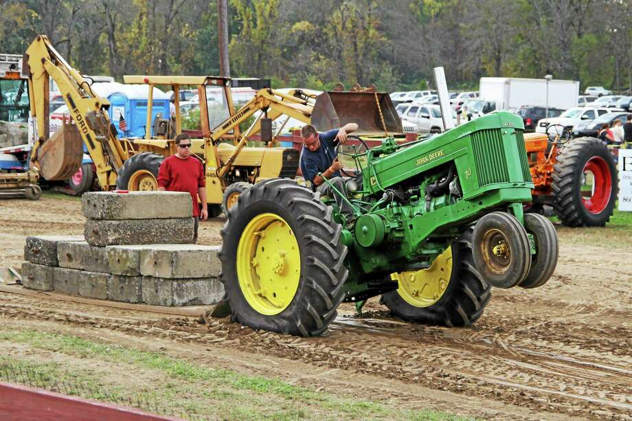 A mug bog competition for pickup truck drivers to get down and dirty is a new feature of this year's Portland Agricultural Fair, which already offers such events like tractor pulling. Photo: Courtesy Mark Chester