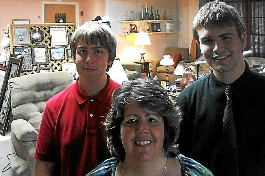 Eileen Daniels, who owns Classic Home Consignment on Highland Avenue in Middletown, is helped by her sons, Tyler and Cody. Photo: Photo Courtesy Eileen Daniels