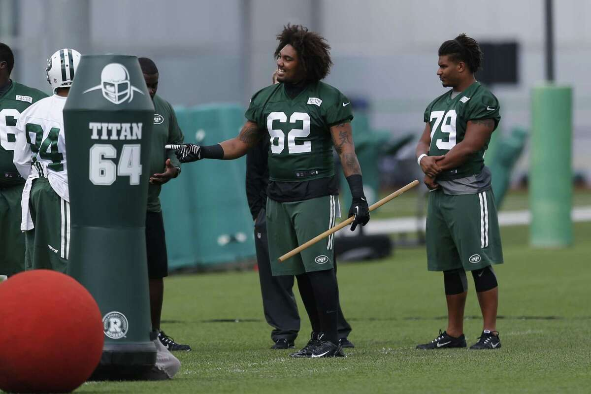 The New York Jets' Leonard Williams holds a stick during an organized team activity at the team's training center in Florham Park, N.J. Williams, a star defensive lineman from USC, is expected to be a major contributor as a rookie.