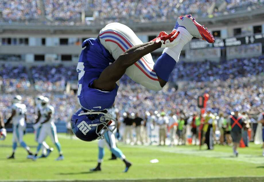 Former New York Giants running back David Wilson, whose NFL career was cut short by a neck injury, hopes to make the 2016 Olympics in the triple jump. His first professional track and field meet will be Saturday at the Adidas Grand Prix in New York. Photo: Mike McCarn — The Associated Press  / FR34342 AP