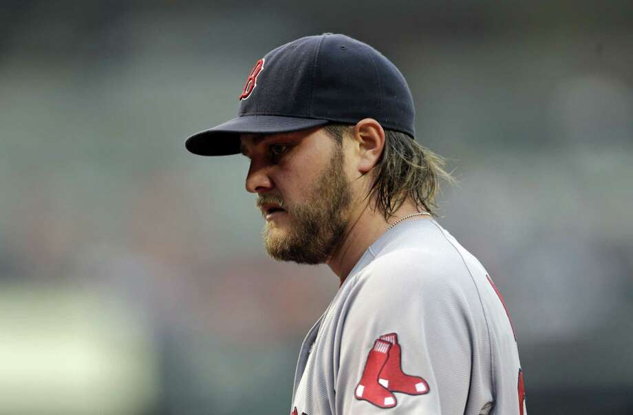 Red Sox starting pitcher Wade Miley walks off the field after the third inning Thursday. Photo: Patrick Semansky — The Associated Press  / AP