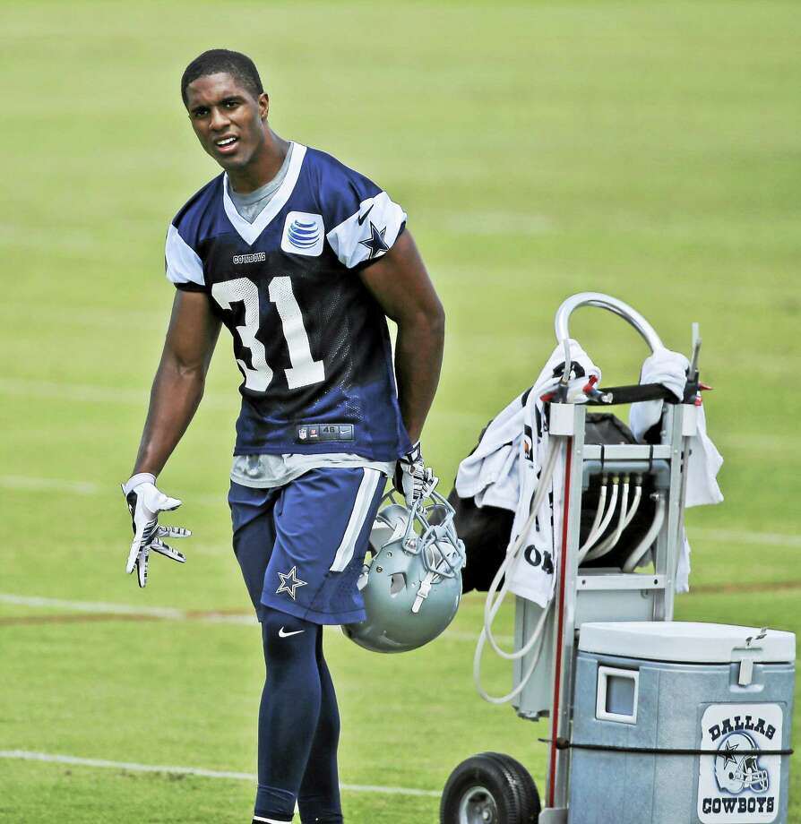 Cowboys Byron Jones (31) walks on the field during an NFL football organized team activity on June 3. Photo: LM Otero — The Associated Press  / AP