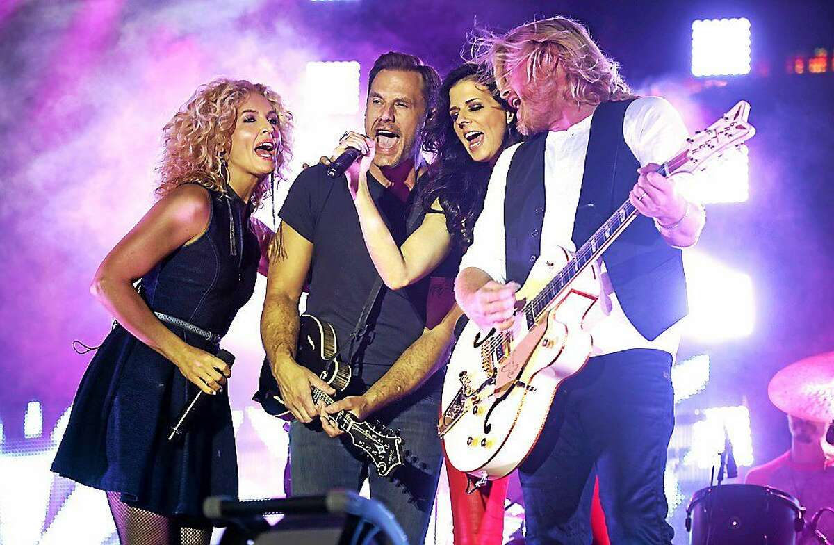 Photo by John Atashian Country music rising stars Little Big Town are shown performing on stage at the Big E Fair on Saturday, Sept. 27. Founded in 1998, the group has included the same four members since its start: Karen Fairchild, Kimberly Schlapman, Jimi Westbrook, and Phillip Sweet. The bands musical style relies heavily on four part vocal harmonies, with all four members alternating as lead singers. The band is currently on tour in support of their brand new album ìPainkillerî which includes the lead single ìDay Drinking.î