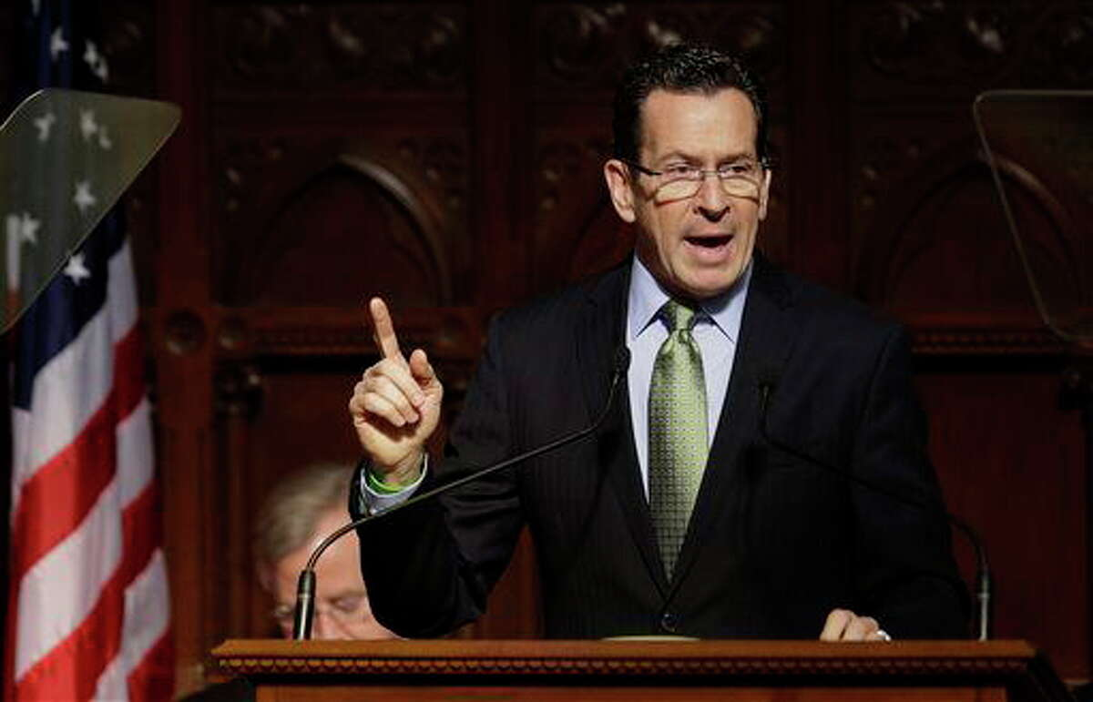 Connecticut Gov. Dannel P. Malloy gestures as he emphasizes a point during his 2014 State of the State address in front of a joint session of the legislature in the House Chambers at the Capitol in Hartford, Conn., Thursday, Feb. 6, 2014. House Speaker Brendan Sharkey sits al left. (AP Photo/Stephan Savoia)