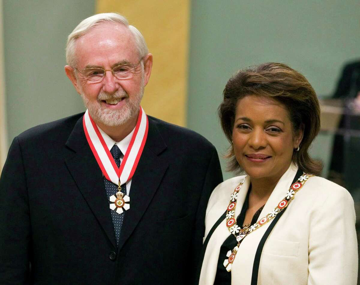 In this April 11, 2008 photo, scientist Arthur McDonald, left, of Kingston, Ontario is invested as Officer to the Order of Canada by Governor General Michaelle Jean during a ceremony at Rideau Hall in Ottawa, Ontario.